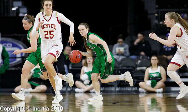 SIOUX FALLS, SD - MARCH 10: Melissa Dailey #3 from North Dakota dribbles behind Sydney Mech #25 from Denver at the 2019 Summit League Basketball Tournament at the Denny Sanford Premier Center in Sioux Falls. (Photo by Dick Carlson/Inertia)