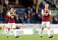 Burnley's Ben Mee (right) and Ashley Westwood applaud the fans at the final whistle<br /> <br /> Photographer Rich Linley/CameraSport<br /> <br /> The Premier League - Burnley v Everton - Saturday 5th October 2019 - Turf Moor - Burnley<br /> <br /> World Copyright © 2019 CameraSport. All rights reserved. 43 Linden Ave. Countesthorpe. Leicester. England. LE8 5PG - Tel: +44 (0) 116 277 4147 - admin@camerasport.com - www.camerasport.com