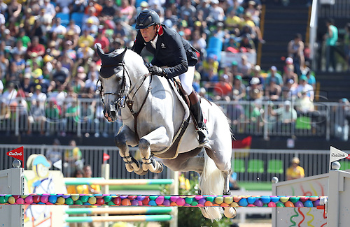 14.08.2016. Rio de Janeiro, Brazil. Philippe Rozier of France on horse Rahotep De Toscane clears an obstacle during the Jumping Individual 1st Qualifier of the Equestrian competition at the Olympic Equestrian Centre during the Rio 2016 Olympic Games in Rio de Janeiro, Brazil, 14 August 2016.