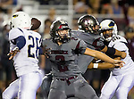 Torrance, CA 09/25/15 - Ryan Carroll (Torrance #2) and Peter Amara (El Segundo #26) in action during the El Segundo - Torrance varsity football game at Zamperini Field of Torrance High School