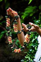 A woman's hands holding a cigar lei