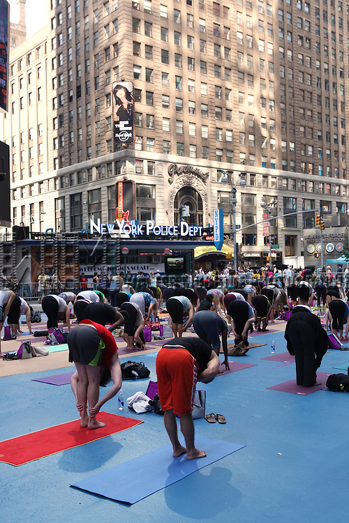 Public Yoga class in Times Square in New York City on 6/20/2012. © Walter McBride/WM Photography