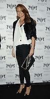Patsy Palmer.attended the Kensington Club new boutique nightclub launch party, The Kensington Club, High Street Kensington, London, England,.20th July 2012..full length black trousers white top leggings fur jacket clutch bag .CAP/CAN.©Can Nguyen/Capital Pictures.