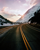 USA, Utah, road with snowcapped Mount Superior in the background, Alta Ski Resort
