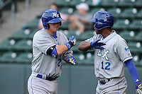 First baseman Ryan O'Hearn (22) of the Lexington Legends is congratulated by Elier Hernandez (12) after hitting a home run in a game against the Greenville Drive on Tuesday, April 14, 2015, at Fluor Field at the West End in Greenville, South Carolina. Lexington won, 5-3. (Tom Priddy/Four Seam Images)