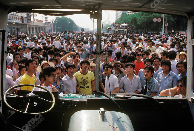Destroyed bus, aftermath of military crackdown on pro-democracy protests, Qianmen area near Tiananmen Square, Beijing, China, June 1989