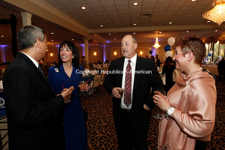 Waterbury, CT- 01 May 2014-050114CM09-  Left to right, Luis Arias, athletic director at Saint Mary School, Bridget Arias, event chair, Russell Mitchell of Waterbury and his Sherry Mitchell, committee member, share a laugh during the Sainy Mary School 125th Anniversay Gala at the Pontelandolfo Community Club in Waterbury on Thursday.   Christopher Massa Republican-American