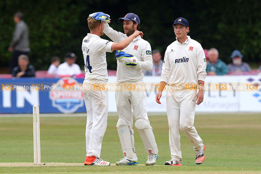 Jamie Porter (R) of Essex is congratulated by James Foster on taking the wicket of Sam Northeast