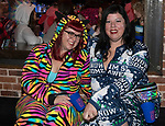 Missy and Kay during the Onesie Crawl held on Saturday night, Nov. 18, 2017 in downtown Reno.