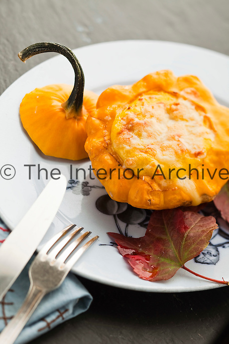 Squash stuffed with chestnut, cheese and egg yolk