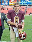 Washington Redskins quarterback Kirk Cousins (8) leaves the field following his team's 31 - 30 victory over the Tampa Bay Buccaneers at FedEx Field in Landover, Maryland on October 25, 2015.  <br /> Credit: Ron Sachs / CNP