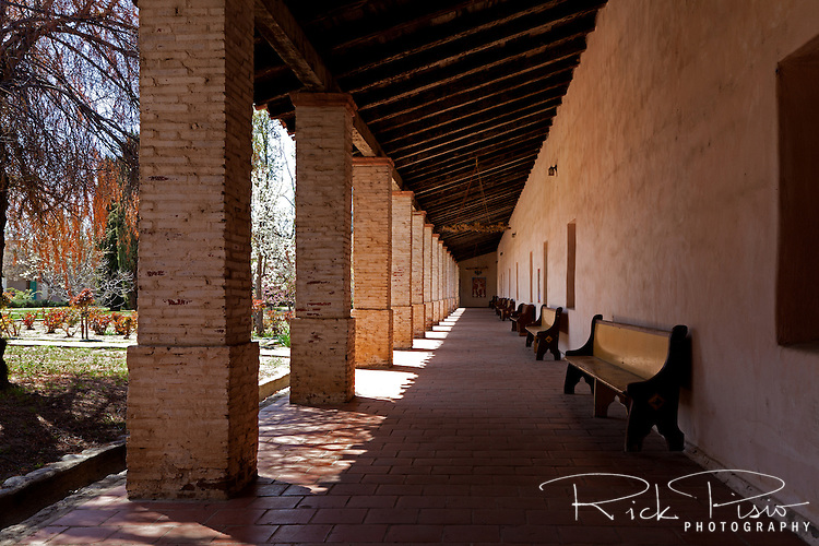 "Interior arcade surround the patio at Mission San Antonio de Padua. Mission San Antonio de Padua sits within the ""Valley of the Oaks"" in Monterey County near the town of Jolon. The mission was founded on July 14, 1771 by Father Junipero Serra and was the third mission in Alta California. Mission San Antonio de Padua is located on eighty pristine acres on what was once the Milpitas Unit of the Hearst Ranch and is today surrounded by the Army's Fort Hunter Ligget Military Reservation."
