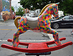 "A view of, ""Confetti"" by artist, Rena Jacobs, one of the 35 Artist painted Rocking Horses on display around Saugerties, NY as part of the Chamber of Commerce sponsored Art in the Village Project titled ""Rockin' Around Saugerties."" This photo taken on Friday, May 26, 2017. Photo by Jim Peppler. Copyright/Jim Peppler-2017."
