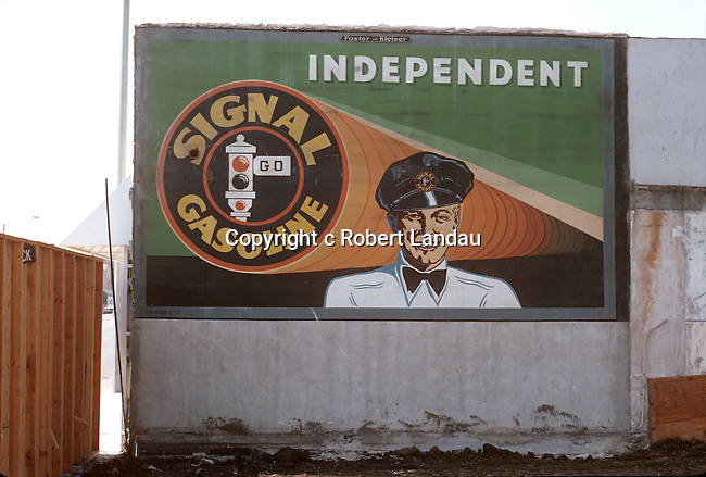 Signal Gasoline billboard from the 1950's revealed when a building is demolished on Melrose Ave. in the 1980's.