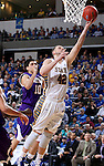 SIOUX FALLS, SD - MARCH 7: Layup by Ian Theisen #42 of South Dakota State with defender Jamie Batish #10 of Western Illinois looking on in the second half of the first round of the men's Summit League Championship Tournament game Saturday evening at the Denny Sanford Premier Center in Sioux Falls, SD.(Photo by Dave Eggen/Inertia)