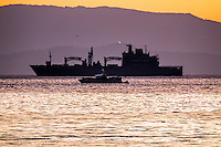 Pictured: Type 702 Berlin class replenishment ship Bonn in the background next to a Greek Coast Guard vessel off the coast of Lesvos Wednesday 09 March 2016<br />