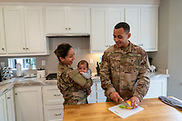 Happy young off duty US Army soldier Jaden with wife and  baby, for sale as stock photography