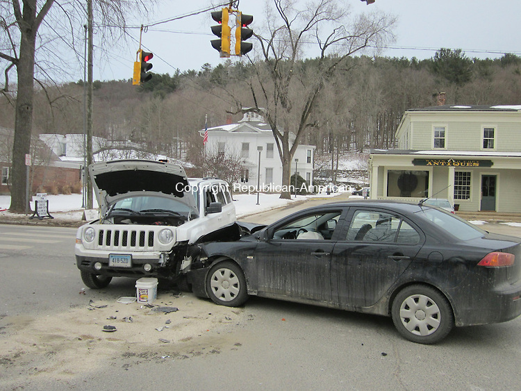 WOODBURY, CT - 28 Jan 2014 - 012814RH03 - Two drivers escaped injury after their cars crashed in the intersection of Main Street South and Sycamore Avenue in Woodbury Tuesday. Louis A. Cerullo, a 27-year-old Watertown resident, was making a left turn from Sycamore Avenue onto Main Street South at 4:07 p.m. when he struck a 2001 Jeep Patriot driven by Kathryn Krigsman-Devine, who was leaving the town office driveway, police said. Both drivers declined medical treatment and both vehicles sustained serious front-end damage requiring tow trucks to remove them from the intersection. Police gave Cerullo a ticket for making an improper turn. Rick Harrison Republican-American