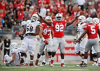 Ohio State Buckeyes defensive lineman Adolphus Washington (92) celebrates sacking Northern Illinois Huskies quarterback Drew Hare (12) during the fourth quarter of the NCAA football game at Ohio Stadium in Columbus on Sept. 19, 2015. (Adam Cairns / The Columbus Dispatch)
