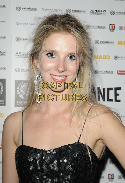 "Sadie Pickering .attended the ""Act Of Godfrey"" UK film premiere, Apollo Piccadilly Circus cinema, London, England, UK, 30th September 2011..portrait headshot smiling  black top sequined sequin .CAP/CAN.©Can Nguyen/Capital Pictures."