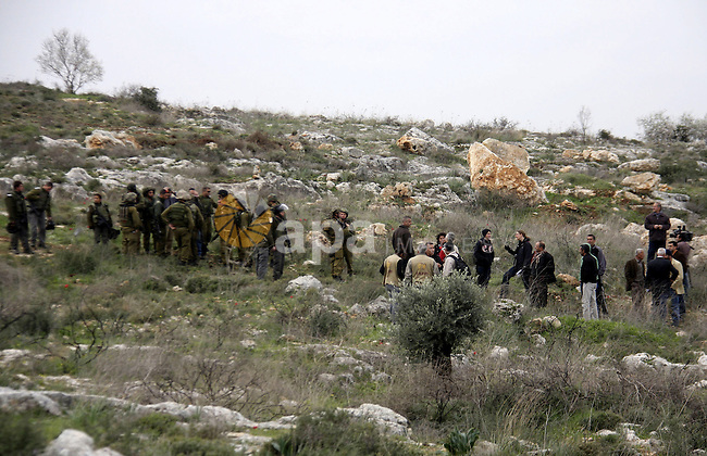 Israeli soldiers scuffle with Palestinians during a clash between Jewish settlers and Palestinians over farming land between the Jewish settlement Shiloh and the West Bank the village of Qusrah near Nablus, Feb. 06, 2012.  Photo by Wagdi Eshtayah