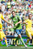 Seattle Sounders FC forward Nate Jaqua (21) runs for the ball in a match against Columbus Crew at CenturyLink Field in Seattle, Washington. The Sounders defeated Columbus Crew, 6-2.