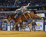 Wade Sundell rides Medicine Woman on his way to winning the RFD TV's The American. Photo by Andy Watson
