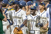 Michigan Wolverines second baseman Ako Thomas (4) celebrates beating the Vanderbilt Commodores during Game 1 of the NCAA College World Series Finals on June 24, 2019 at TD Ameritrade Park in Omaha, Nebraska. Michigan defeated Vanderbilt 7-4. (Andrew Woolley/Four Seam Images)