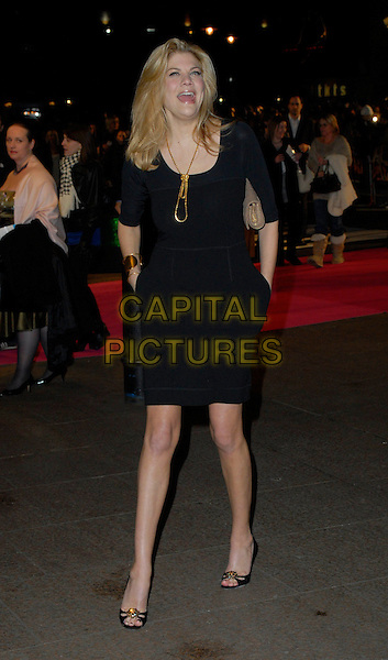 """KRISTEN JOHNSTON.Attends the UK Premiere of """"Music & Lyrics"""",.Odeon Leicester Square, .London, England, February 5th 2006..full length black dress clutch bag gold necklace.CAP/CAN.©Can Nguyen/Capital Pictures"""