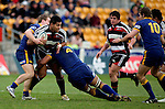 Niva Ta'auso is taken by Filipo Levi & Toby Morland during the Air NZ Cup game between Counties Manukau & Otago played at Mt Smart Stadium,Auckland on the 29th of July 2006. Otago won 23 - 19.