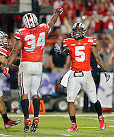 Ohio State Buckeyes running back Carlos Hyde (34) celebrates with Ohio State Buckeyes quarterback Braxton Miller (5) after scoring a rushing touchdown against Clemson Tigers during the 3rd quarter in the Discover Orange Bowl at Sun Life Stadium in Miami Gardens, Florida on January 3, 2014.(Dispatch photo by Kyle Robertson)