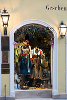 Window display of dirndl dresses in Kaiser am Platzll gift shop in Pfisterstrasse in Munich, Bavaria, Germany