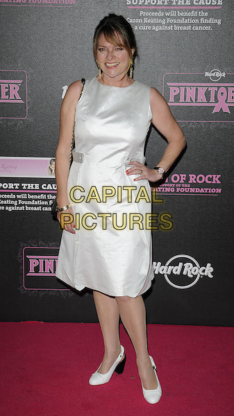 JANET ELLIS .attending the Pinktober Women of Rock Charity Concert, Royal Albert Hall, London, England, UK,.1st November 2009..full length white sleeveless dress shoes  hand on hip  .CAP/CAN.©Can Nguyen/Capital Pictures.