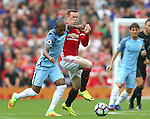 Fernandinho of Manchester City tussles with Wayne Rooney of Manchester United during the Premier League match at Old Trafford Stadium, Manchester. Picture date: September 10th, 2016. Pic Simon Bellis/Sportimage
