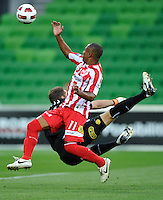 MELBOURNE, AUSTRALIA - JANUARY 09: Alex Terra of the Heart and  Glen Moss of United contest the ball during the round 23 A-League match between the Melbourne Heart and Gold Coast United at AAMI Park on January 19, 2011 in Melbourne, Australia. (Photo by Sydney Low / Asterisk Images)