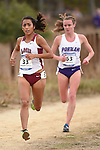 November 1, 2014; Sunnyvale, CA, USA; Loyola Marymount Lions runner Grace Graham-Zamudio (33) and Portland Pilots runner Tansey Lystad (63) competes during the WCC Cross Country Championships at Baylands Park.