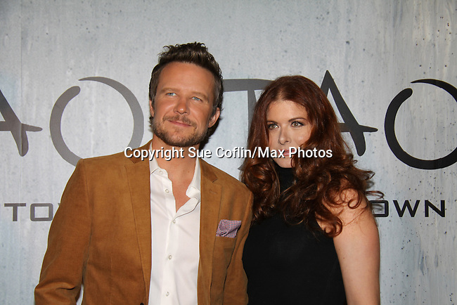 Will Chase & Debra Messing at TAO Downtown Grand Opening NYC on September 28, 2013 in New York City, New York.  (Photo by Sue Coflin/Max Photos)