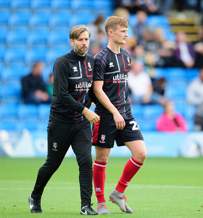 Lincoln City's assistant manager Nicky Cowley, left, speaks to Callum Connolly during the pre-match warm-up<br /> <br /> Photographer Andrew Vaughan/CameraSport<br /> <br /> The EFL Sky Bet League One - Wycombe Wanderers v Lincoln City - Saturday 7th September 2019 - Adams Park - Wycombe<br /> <br /> World Copyright © 2019 CameraSport. All rights reserved. 43 Linden Ave. Countesthorpe. Leicester. England. LE8 5PG - Tel: +44 (0) 116 277 4147 - admin@camerasport.com - www.camerasport.com