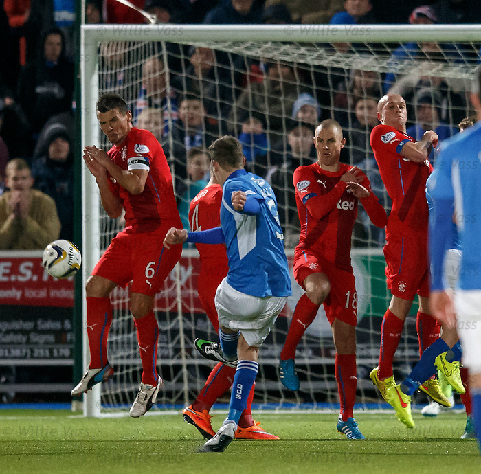 Kevin Holt curls in the opening goal for QOS around the Rangers wall from a free-kick