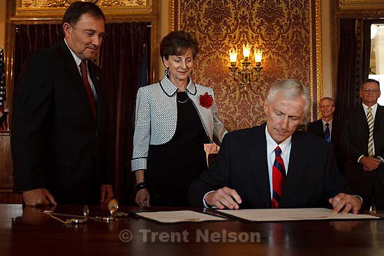 Salt Lake City - Greg Bell resigned the Utah Senate and was sworn in as the state's Lieutenant Governor Tuesday, September 1 2009 at the State Capitol.   with his wife JoLynn and governor Gary Herbert at left
