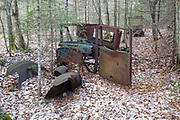 Abandoned car in the Tunnel Brook drainage of Benton, New Hampshire. During the 1900s there was a road, connecting Benton and Warren, through Tunnel Brook Notch. And it is believed the road was closed in 1927 because of landslides. This is possibly a 1926 Dodge coupe.