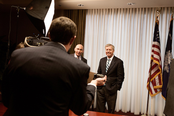 March 26, 2013. Columbia, South Carolina. Sen. Lindsey Graham (right) heads into a FOX NEWS interview after addressing members of the press on the issue of immigration reform. He was joined by Dr. Jim Goodroe, a state evangelical leader, and Hal Stevenson, the owner of Grace Outdoor.. Sen. Lindsey Graham, R- South Carolina, is up for reelection in 2014. He spent some time talking to his base back home about issues such as immigration reform as he readies himself for his campaign run..