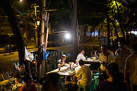 People eat noodles at a streetside stand on Shaanxi Road near Chaotianmen Harbor in central Chongqing.