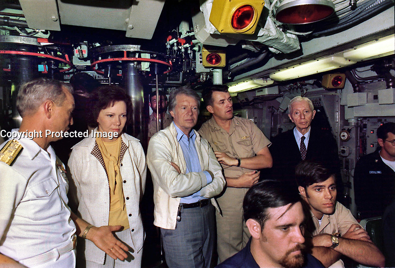 Rosalynn Carter, Jimmy Carter and Admiral Hyman Rickover (far right) aboard the submarine USS Los Angeles shortly after her commissioning, 28 May 1977