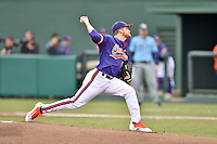 Clemson Tigers starting pitcher Clate Schmidt (32) delivers a pitch during a game against the Maine Black Bears at Doug Kingsmore Stadium on February 20, 2016 in Clemson, South Carolina. The Tigers defeated the Black Bears 9-4. (Tony Farlow/Four Seam Images)