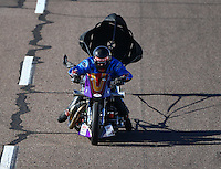 Feb 27, 2016; Chandler, AZ, USA; NHRA top fuel harley motorcycle rider Jay Turner slows with the help of a parachute during qualifying for the Carquest Nationals at Wild Horse Pass Motorsports Park. Mandatory Credit: Mark J. Rebilas-