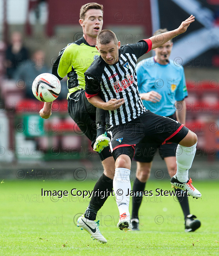 Pars' Ryan Wallace gets to the ball ahead of Stranraer's Grant Gallagher.