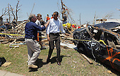 United States President Barack Obama and Missouri Governor Jay Nixon (L) speak during a visit to the community that was devastated a week ago by a tornado on May 29, 2011 in Joplin, Missouri. The tornado, which was packing winds of more than 200 mph, is now considered to hold the record for the highest death toll in U.S. history.  .Credit: Joe Raedle / Pool via CNP