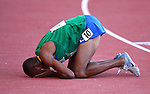 GUADALAJARA, MEXICO - OCTOBER 24:  Joilston Silva of Brazil #10 collapses after finishing in the Men's 5,000 M Final during the Athletics Competition on Day Nine of the XVI Pan American Games on October 24, 2011 in Guadalajara, Mexico.  (Photo by Donald Miralle for Mexsport) *** Local Caption ***