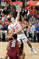 Virginia forward/center Mike Tobey (10) reaches for the rebound over Virginia Tech guard/forward Jarell Eddie (31) during the game Saturday in Charlottesville, VA. Virginia won 65-45.